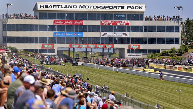 Fans watch as Top Fuel cars get set to race during the 2019 Menards NHRA Heartland Nationals at Heartland Motorsports Park. This year's event has been rescheduled for Aug. 21-23 because of the coronavirus.