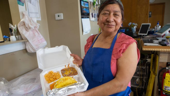 Juama Silva, of Zoila's Cafe, presents the beef burrito house plate Friday afternoon. The plate can be purchased for $8.99 plus tax.