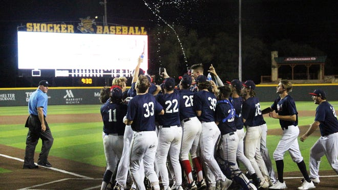Hunter Gibson celebrates with his teammates after the walk off, game-winning home run against the Colorado Cyclones in the elimination round of the NBC World Series on Wednesday, August 5 at Wichita State's Eck Stadium.