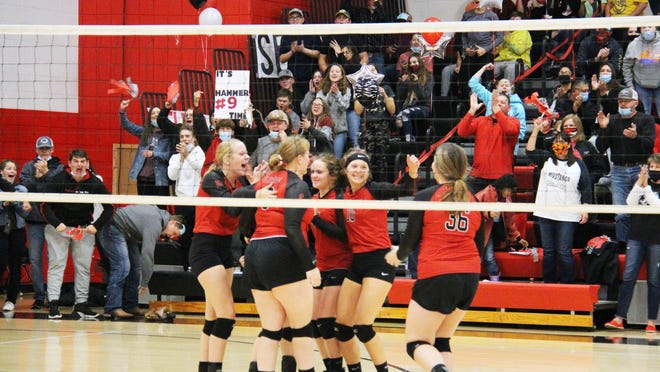 The Flinthills Lady Mustangs celebrate winning a point in the match's opening set on Wednesday, Oct. 28 at Flinthills High School. The Lady Mustangs would take the first set 25-18 over Pratt Skyline in the Class 1A-I State Quarterfinals.