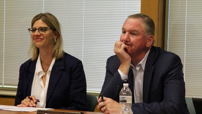 West Ottawa Public Schools Superintendent Thomas Martin, right, at a board of education meeting in 2018. Martin announced Friday that he will be retiring, effective Jan. 1, 2021.