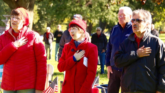 People recite the Pledge of Allegiance during a Liberty Rally held in Kollen Park in Holland on Saturday, Sept. 19, 2020.