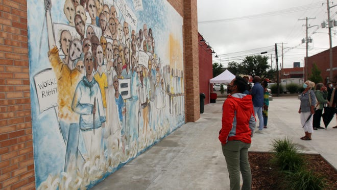 """Jocelyn Woodson's """"In Peace"""" mural at the Chester I. Lewis Plaza will get a protective coating applied next week."""