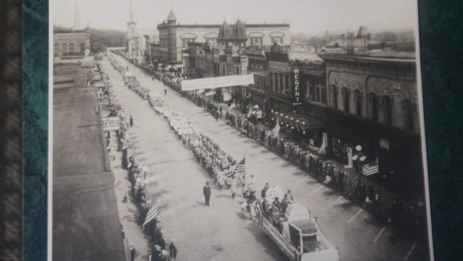 This week's photo shows Main Street Ionia during a parade for the Mayor of Ionia, Fred Green, who is running for Governor of the State of Michigan in 1926. At the top of the photo on the left are the steeples of the Baptist church on the left and the M. E. church on the right. The Bailey hotel is near the M. E. church location. Landmark Ionia architecture is visible including the twin towers of the Silver - Graff buildings. The Regent Theatre sign is prominent along with the entrance to the building. In January of 1931 the up-to-date, Art Deco style Ionia Theatre opened on the site of the former Bailey hotel, and anything considered useable from the Regent was moved to that building.