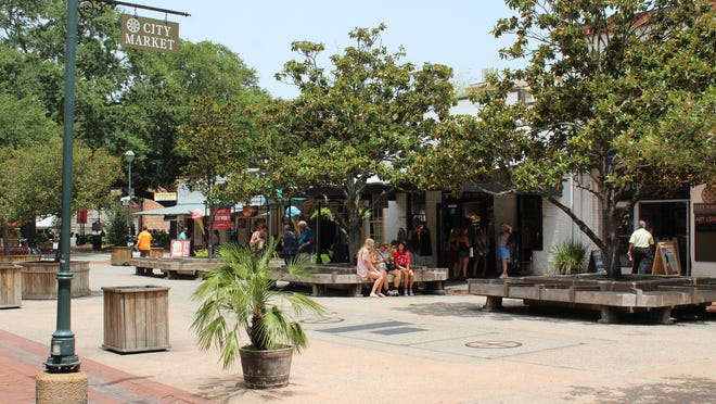 Visitors to Savannah take in City Market in the downtown area. Many downtown businesses benefited from the Paycheck Protection Program.