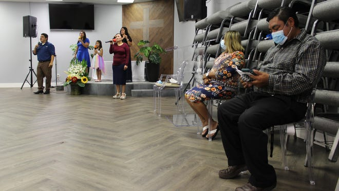 A handful of congregants livestream Saturday services at the otherwise empty Savannah Hispanic Seventh-day Adventist Church, which launched its online presence in response to the pandemic.