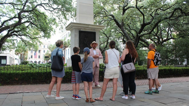 Walking-tour participants in Savannah's Johnson Square on May 30.