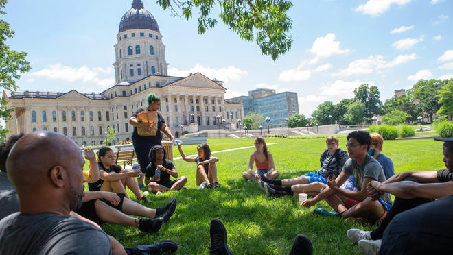 Youth and community leaders of Topeka met for a gathering of the minds Thursday afternoon on the Statehouse grounds to discuss how they see change happening in Topeka.