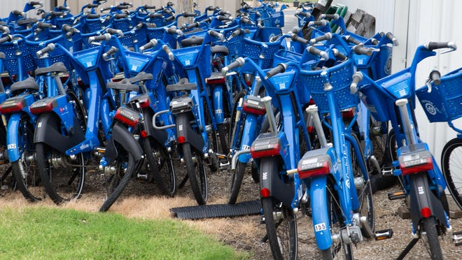 Topeka Metro bicycles sit in storage outside a maintenance facility Monday afternoon.