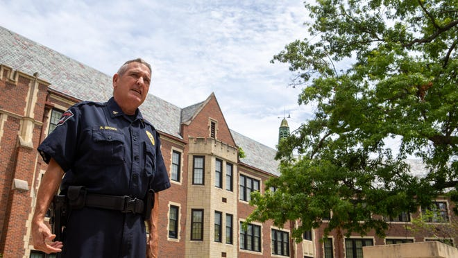 Retiring Unified School District 501 Police Chief Ron Brown reflects on his career Thursday afternoon while standing outside Topeka High School.