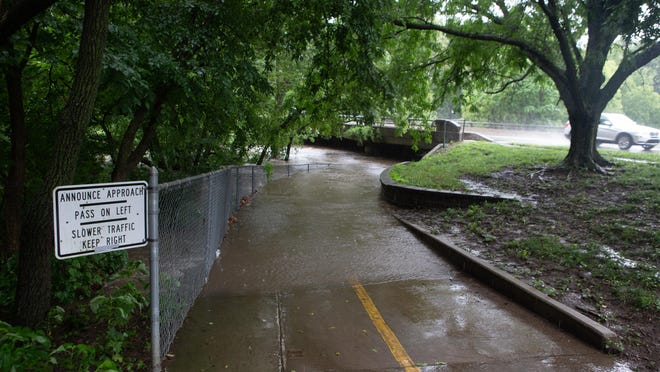 The Shunganunga Creek on July 30 overflowed its banks and covered the Shunga Trail at sites that included the bridge that passes over that creek on S.W. Washburn Avenue, just north of S.W. 26th Street.