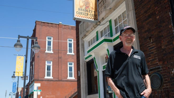 Bradley's Corner Cafe owner Bradley Jennings stands in front of his restaurant Friday afternoon in NOTO. Jennings recently announced his retirement and new management that will take over the restaurant.