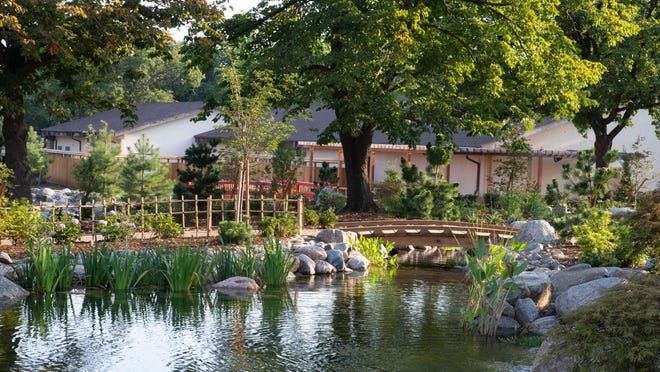 Koi ponds featuring lily pads and other water flowers are visible throughout the new Kay's Garden at the Topeka Zoo.