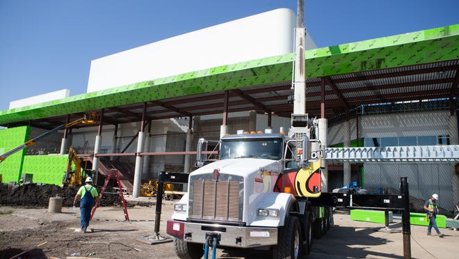 Construction crews work on the new front entrance of the Stormont Vail Events Center Friday morning.