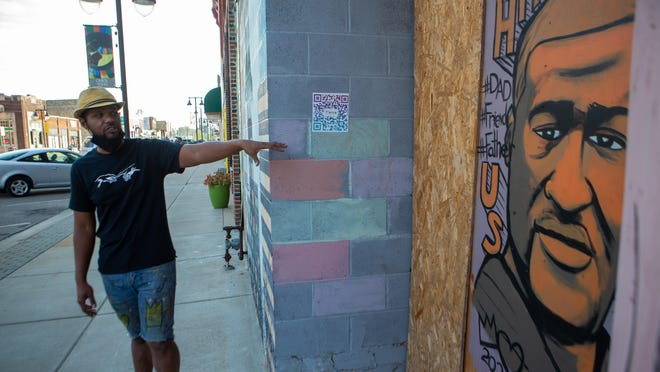Local artist Jordan Brooks on Thursday talks about his mural of George Floyd, a Minnesota man, who was killed by Minneapolis police officer Derek Chauvin earlier this year, while walking around NOTO.