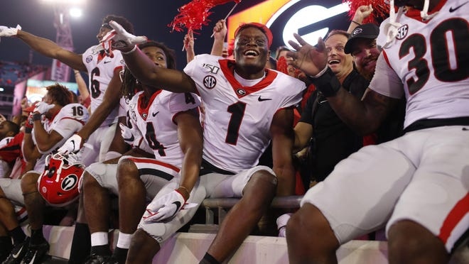 Georgia wide receiver George Pickens (1) celebrates with fans after getting a win in a NCAA football game between Georgia and Florida in Jacksonville, Fla., on Saturday, Nov. 2, 2019. Georgia won 24-17.