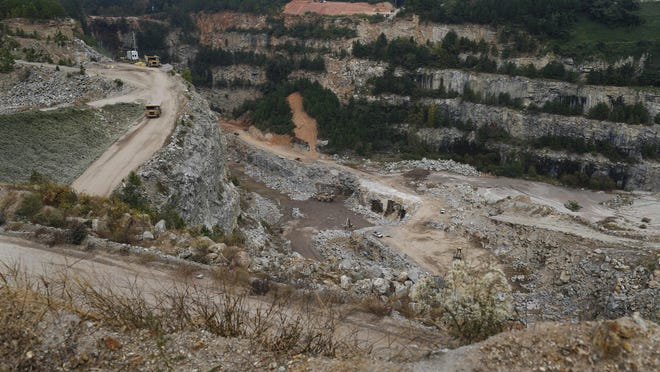 Trucks move through Rock Hill Quarry off Winterville Road in Athens on Friday. The Athens-Clarke County Commission voted to buy the 190-acre site for future water storage.