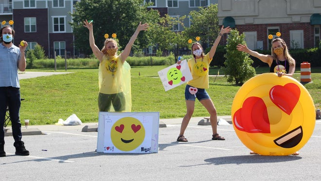 FernLeaf staff wave to students that drove through an end-of-year parade, following remote instruction at the end of the 2019-20 school year.