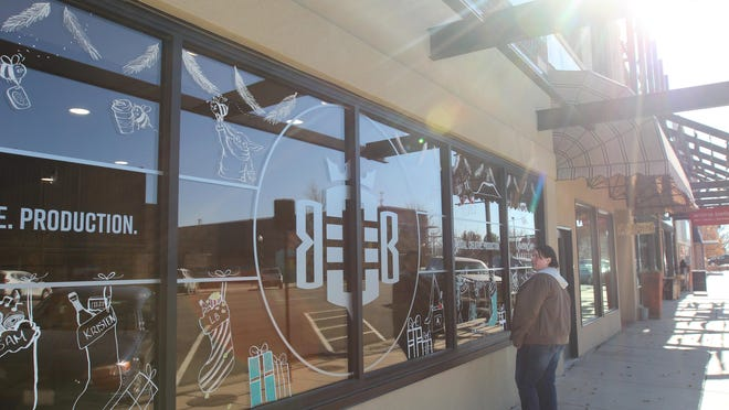 Queen Bee employees decorated their front windows with pop culture icons on Monday.