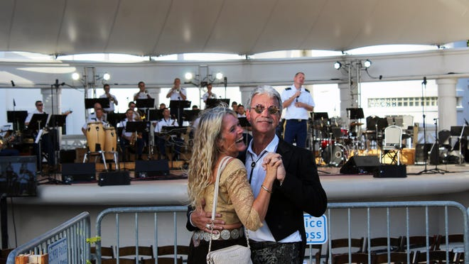 Musician Dobby Simmons and local artist Michele Snell dance to the U.S. Army 3rd Infantry Division Stage Band at Picnic in the Park in this file photo. Forsyth Park is a perfect location for socially distant concerts to support local musicians.