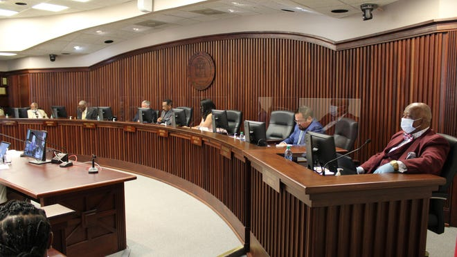 The Chatham County Commission meets at its refurbished chambers, with plexiglass dividers added as a COVID-19 precaution.