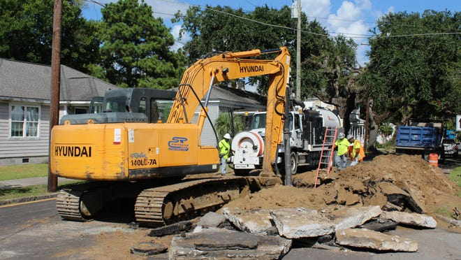 Workers repair a collapsed sewer main on Savannah's E. Anderson St. on July 23.