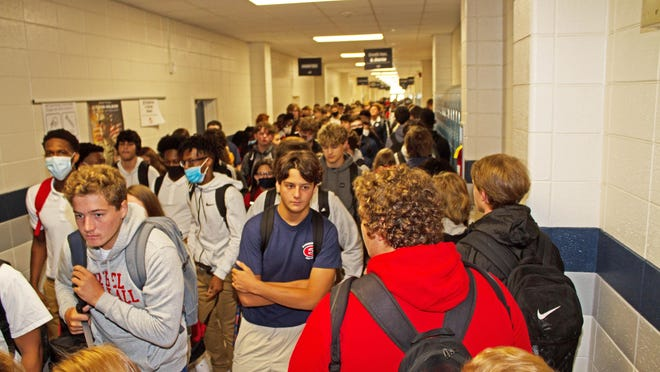 Students were close to each other as they changed classes Wednesday at Effingham County High School. Students are encouraged but not required to wear masks.