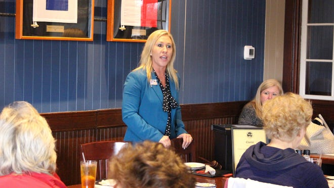 Republican Marjorie Taylor Greene speaks to a GOP women's group on March 3, 2020, in Rome, Ga. Greene is one of nine Republicans seeking her party's nomination in Georgia's 14th Congressional District on Tuesday, June 9, 2020.