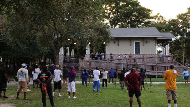 """Family members of late County Commissioner James """"Coach"""" Holmes speak during his Aug. 21 vigil at Savannah's Mother Matilda Beasley Park."""