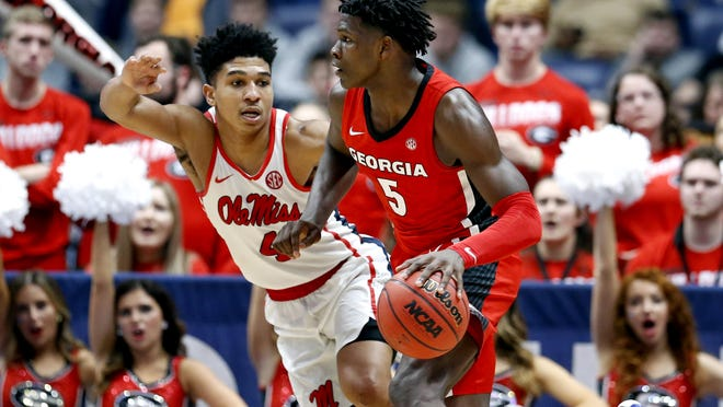 Georgia guard Anthony Edwards (5) drives against Mississippi's Breein Tyree (4) in the Southeastern Conference Tournament on March 11 in Nashville, Tenn. Georgia won 81-63.