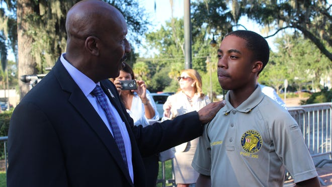 Savannah Police Chief Roy Minter talks with 15-year-old explorer Dekevian George during a community meet and greet.