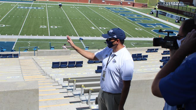 Georgia Southern athletic director Jared Benko shows media members the health and safety precautions taken at Paulson Stadium ahead of the football season opener against Campbell on Sept. 12 in Statesboro.