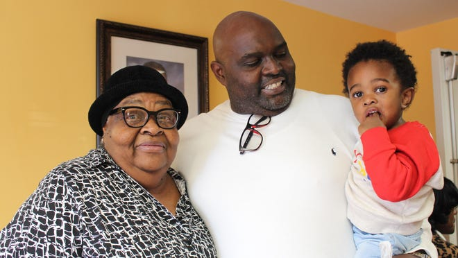 Georgia director of player development Jonas Jennings visits with residents of the College Park Housing Authority in 2019 during his turkey drive. (Photo from Insights Marketing).