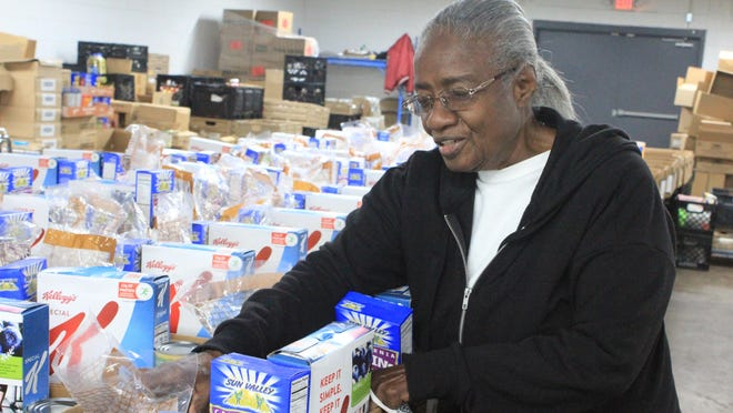 Barbara Cheeks handles food boxes on Wednesday, Nov. 11, 2020, at Antioch for Youth & Family Headquarters in Fort Smith. Antioch for Youth & Family has five volunteers between 75-85 years old and Cheeks is among those.