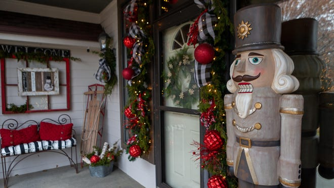 Chris Page decorated her porch with festive green and red colors, holiday ornaments and a giant nutcracker as part of the first annual Topeka Holiday Porch Tour.