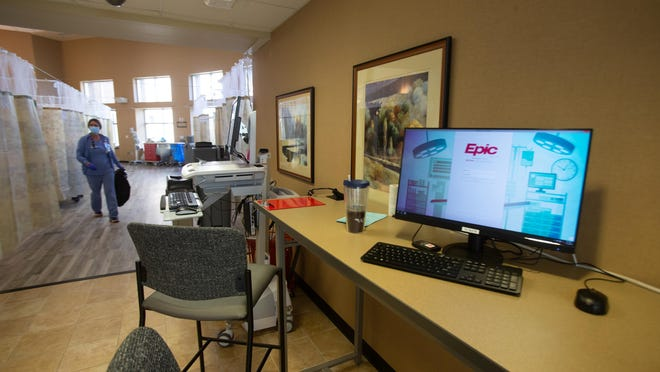 A makeshift work station is set up between hallways that were converted into hospital rooms at Stormont Vail Hospital.