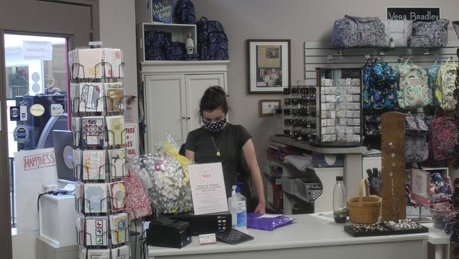 Emily Collette, a volunteer at Hang Loose in the Gallery of Shops, works the front counter on Friday. The boutique and salon was one of 22 downtown Adrian businesses to receive COVID-19 relief from the Michigan Economic Development Corp.