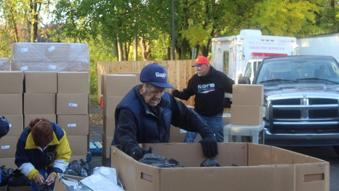 Dean Barricklow, 97, of Madison Township is a regular volunteer at the Salvation Army. Every Tuesday morning, he helps distribute free food to those in need.