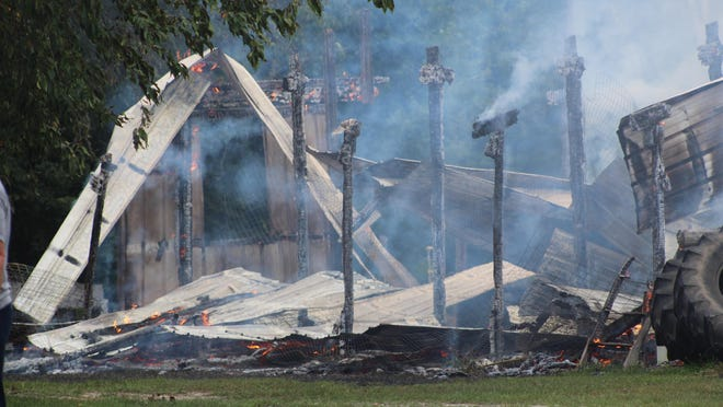 Two local fire departments worked together last week to extinguish a barn fire on Walker Road. Photo by Kortny Hahn