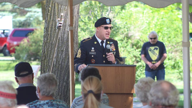 Cheboygan County Sheriff and Army National Guard Command Sergeant Major Dale Clarmont was the keynote speaker at the dedication ceremony Sunday afternoon, encouraging everyone to reflect on those who paid the ultimate sacrifice for their country. Photo by Kortny Hahn
