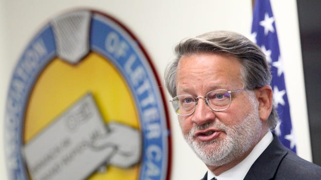 U.S. Sen. Gary Peters, D-Michigan, speaks during a press conference on Tuesday, Aug. 25, at the National Association of Letter Carriers Local 56 office in Kentwood, Mich. Peters, who launched an investigation into delays with the U.S. Postal Service, said USPS officials are not being transparent with information on reported delays in services.