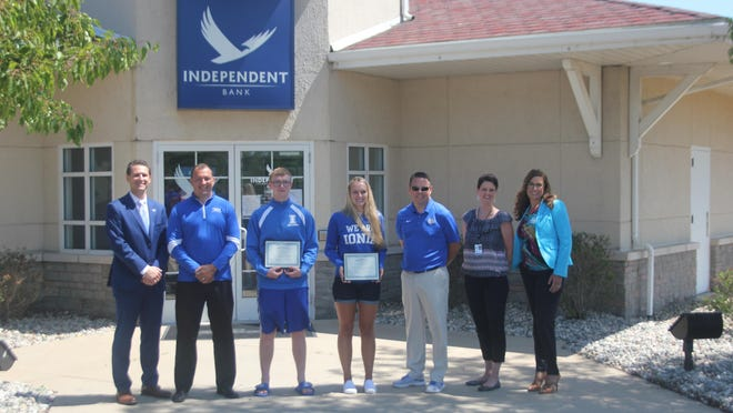 Collin Stewart and Taylor Kirby were named the Independent Bank Athletes of the Year at Ionia High School for 2020. Pictured, from left to right: Boomer Hoppough of Independent Bank, Ionia High School Principal Ben Gurk, Stewart, Kirby, IHS Athletic Director Andy Barr, IHS Assistant Principal Amber Mitchell and Jenny Dinehart of Independent Bank.