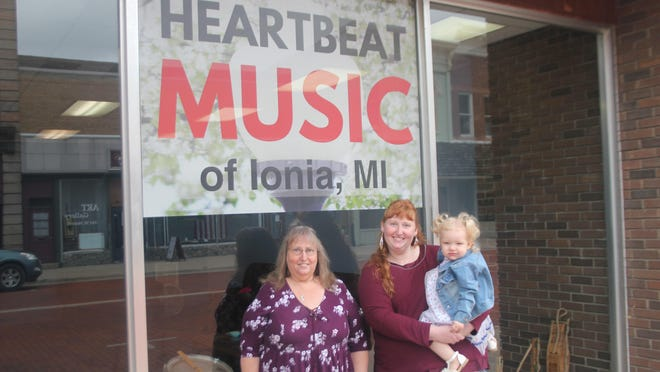 From left: Sally Harris, her daughter Sarah Brown and Brown's daughter, Sophie pose in front of Heartbeat Music of Ionia, 341 W. Main St., in downtown Ionia Thursday, Sept. 10.