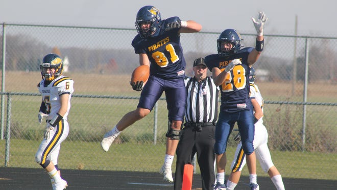 Pewamo-Westphalia's Nick Noel (No. 81) and Connor Thelen celebrate Noel's second quarter touchdown against North Muskegon during a varsity football game Saturday, Nov. 7, at Pewamo-Westphalia High School. P-W won the game, 18-17.