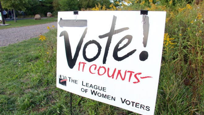 A sign encourages voting at the League of Women Voters Holland Area annual kickoff event Thursday, Sept. 18, 2020 at the Outdoor Discovery Center in Holland, Mich.