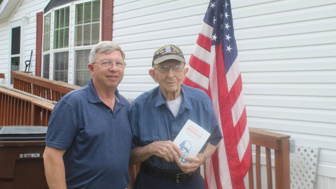 John Jackson, left, and his father, Chuck, stand outside of the World War II veteran's home at Hidden River South, Adrian. John published a book about his father's time as an ammo bearer with the 10th Mountain Division in Europe. Chuck, a Palmyra native, received a Bronze Star for his actions during the war.