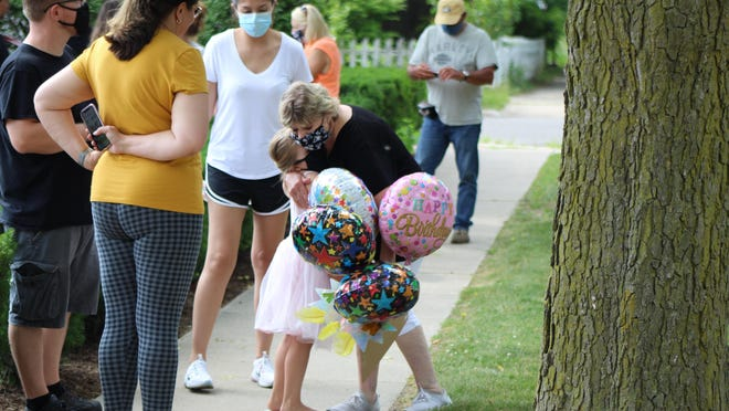 Mary McDonnell and her great-granddaughter Carson Byrnes, 5, hug Wednesday afternoon in Adrian. It was the first time the two had seen each since the coronavirus pandemic started. It was all part of a special 80th birthday for McDonnell, who was treated to a surprise parade.