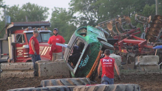 Red flags were flown on the track during the Figure 8 Demo Derby at the Lenawee County Fair in 2019 when a car became stuck against the stone wall on its side.