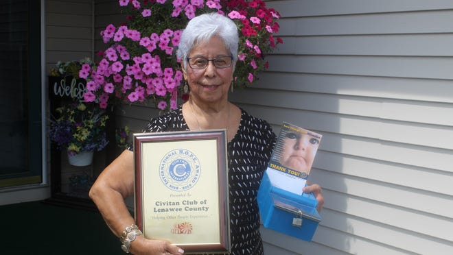 Civitan of Lenawee member Sandy Trevino holds the club's HOPE Award. The Civitan club that has the most participation and best performance in the candy box program receives the award. The candy box program, where people take a mint and in exchange donate money, raises funds for disability research.