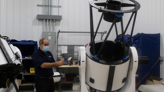 PlaneWave Instruments CEO Richard Hedrick discusses one of the company's telescopes during an open house tour on Tuesday. PlaneWave manufactures a number of different model telescopes.